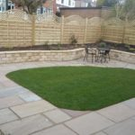 The lawn at the same height as the paving means no lawn edging. <br />Then a new fence and a bit of planting.